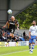 Newport County's defender David Pipe keeps the ball in play as Bury's Euan Holden looks on. Skybet Football League two match, Bury v Newport county at Gigg Lane in Bury on Saturday 5th Oct 2013. pic by David Richards, Andrew Orchard sports photography,