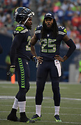 Aug 25, 2017; Seattle, WA, USA; Seattle Seahawks cornerback Richard Sherman (25) talks defensive back Neiko Thorpe (23) during a NFL football game against the Kansas City Chiefs at CenturyLink Field. The Seahawks defeated the Chiefs 26-13.