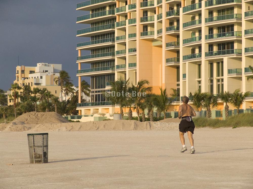 Man running on the beach of Miami Beach USA