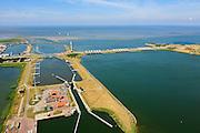 Nederland, Noord-Holland, Den Oever, 14-07-2008; begin Afsluitdijk, waterkering tussen Waddenzee en IJsselmeer (rechts en onder, voorheen Zuiderzee); aanleg van de dijk vormde onderdeel Zuiderzeewerken, initiatief van ingenieur Cornelis Lely; Stevinsluizen: onder in beeld in de dijk de schutsluizen , in de dijk de uitwateringssluizen en  rechts het 'eiland' Robbenplaat.<br /> luchtfoto (toeslag op standard tarieven);<br /> aerial photo (additional fee required);<br /> copyright foto/photo Siebe Swart.