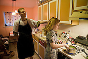 Michael Rae and his partner April Smith in suburban Philadelphia, PA, preparing dinner in the kitchen. (Michael Rae is featured in the book What I Eat: Around the World in 80 Diets.) Both Michael and April adhere to a severe caloric restriction diet, eating less than 2,000 calories a day in the hopes that the diet will increase longevity. MODEL RELEASED.