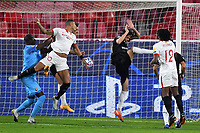 SEVILLE, SPAIN - OCTOBER 28: Diego Carlos and Jules Kounde of FC Sevilla and Alfred Gomis and Jonas Martin of Stade Rennais during the UEFA Champions League Group E stage match between FC Sevilla and Stade Rennais at Estadio Ramon Sanchez-Pizjuan on October 28, 2020 in Seville, Spain. (Photo by Juan Jose Ubeda/ MB Media).