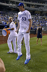 May 30, 2017 - Kansas City, MO, USA - Kansas City Royals starting pitcher Eric Skoglund leaps into the air after getting the Salvy Splash from Salvador Perez following Skoglund's major league debut with a 1-0 win against the Detroit Tigers at Kauffman Stadium in Kansas City, Mo., on Tuesday, May 30, 2017. (Credit Image: © John Sleezer/TNS via ZUMA Wire)
