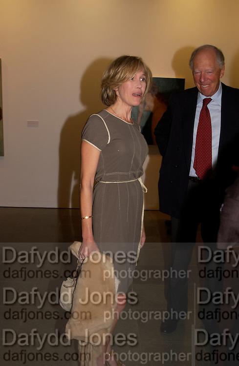 Eva Rausing and Lord RothschildJohn Currin, Serpentine Gallery, 8 September 2003. © Copyright Photograph by Dafydd Jones 66 Stockwell Park Rd. London SW9 0DA Tel 020 7733 0108 www.dafjones.com