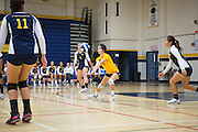 Milpitas junior Jalaena Bumagat (5) digs a Monta Vista High School serve on Sept. 10, 2012.  Milpitas would go on to lose in 4 sets, 7-25, 16-25, INSERT SCORE, 17-25.  Photo by Stan Olszewski/SOSKIphoto.