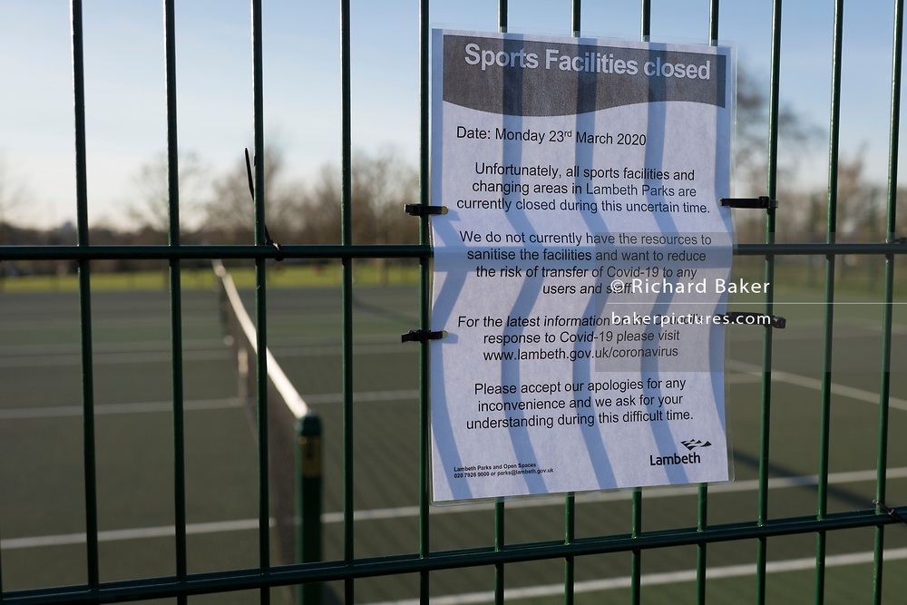 The day after UK Prime Minister Boris Johnson imposed unprecedented restrictions of movement for millions of Britons who were told to stay at home unless their key jobs or journeys were essential. Told to take a single exercise session per day but with tennis facilities now closed by Lambeth council, courts are now un-used in Brockwell Park in Herne Hill SE24, on 24th March 2020.