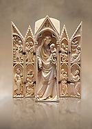 Medieval Gothic ivory tabernacle depicting the Virgin and Child with scenes from the Annunciation, Nativity, the adoration of the Magi and the presentation at the Temple  made in Paris in second quarter of the 14th century and is a typical example of tabernacles made in Paris at that period.  inv 2587, The Louvre Museum, Paris. .<br /> <br /> If you prefer you can also buy from our ALAMY PHOTO LIBRARY  Collection visit : https://www.alamy.com/portfolio/paul-williams-funkystock . Type -    Medieval Ivory         - into the LOWER SEARCH WITHIN GALLERY box. Refine search by adding background colour, place, museum etc<br /> <br /> Visit our MEDIEVAL ART PHOTO COLLECTIONS for more   photos  to download or buy as prints https://funkystock.photoshelter.com/gallery-collection/Medieval-Middle-Ages-Art-Artefacts-Antiquities-Pictures-Images-of/C0000YpKXiAHnG2k