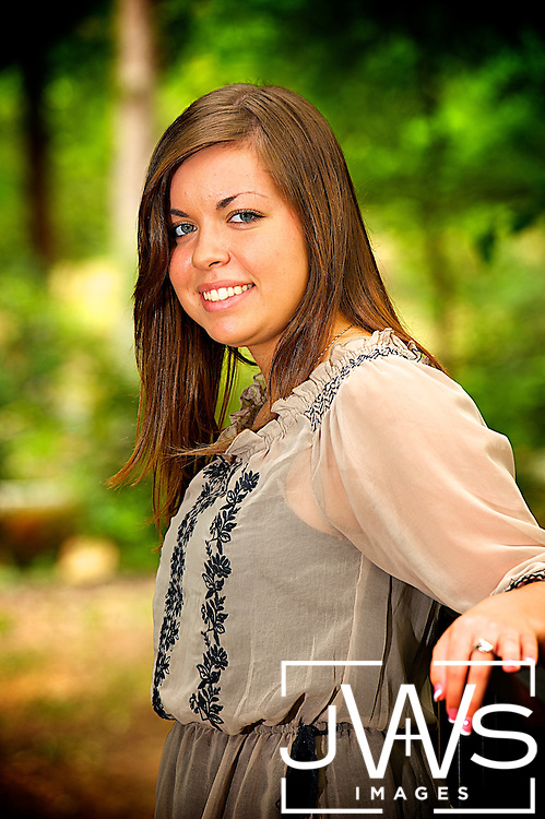 Senior picture take along a fence line in Texas.