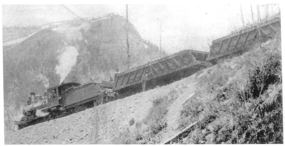 3/4 view from below of a Crystal River RR train with Ingoldsby Patent Dump Cars including gondola #224.<br /> Crystal River Railroad