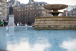 © Licensed to London News Pictures. 12/12/2017. London, UK. Frozen water fountains in Trafalgar Square, London as temperatures drop below -3C across the capital overnight on Tuesday, 12 December 2017. Photo credit: Tolga Akmen/LNP