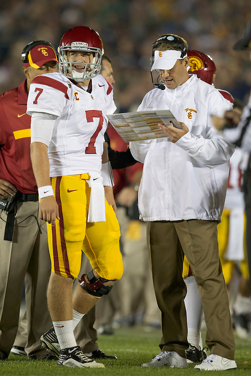 USC head coach Lane Kiffin and quarterback  Matt Barkley (#7)discuss strategy during third quarter of NCAA football game between Notre Dame and USC.  The USC Trojans defeated the Notre Dame Fighting Irish 31-17 in game at Notre Dame Stadium in South Bend, Indiana.