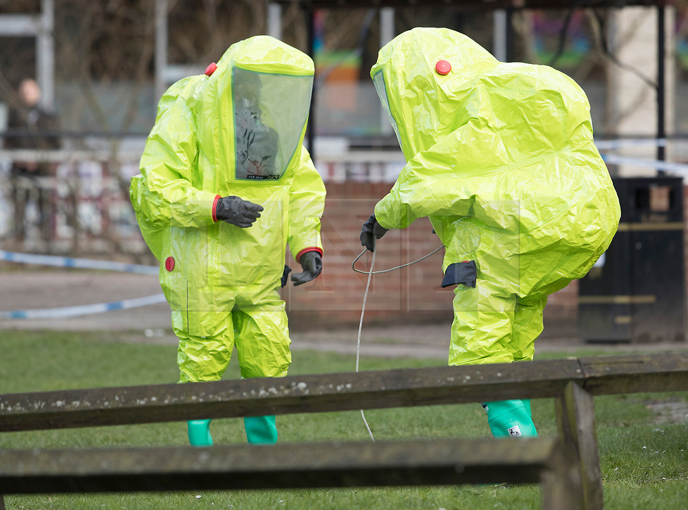 © Licensed to London News Pictures. 08/03/2018. Salisbury, UK. Salisbury. Firefighters in hazardous material suits adjust a police tent covering a park bench next to The Maltings shopping centre in Salisbury where Former Russian spy Sergei Skripaland his daughter Yulia were found after being poisoned with nerve agent. The couple where found unconscious on bench in Salisbury shopping centre. Authorities continue to investigate. Photo credit: Peter Macdiarmid/LNP