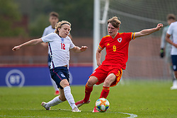 NEWPORT, WALES - Friday, September 3, 2021: Wales' Iwan Roberts (R) is tackled by England's Sammy Braybrooke during an International Friendly Challenge match between Wales Under-18's and England Under-18's at Spytty Park. (Pic by David Rawcliffe/Propaganda)