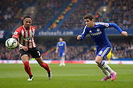 Oscar of Chelsea chasing the ball with Nathaniel Clyne of Southampton looking on. Barclays Premier league match, Chelsea v Southampton at Stamford Bridge in London on Sunday 15th March 2015.<br /> pic by John Patrick Fletcher, Andrew Orchard sports photography.