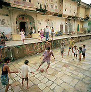Children playing football on the streets, Rajahstan, India