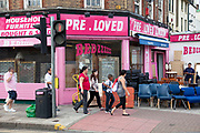The Pre Loved furniture shop on Camberwell Road in South London. This is a a multicultural area in South London where different people of all nationalities and races mix together.