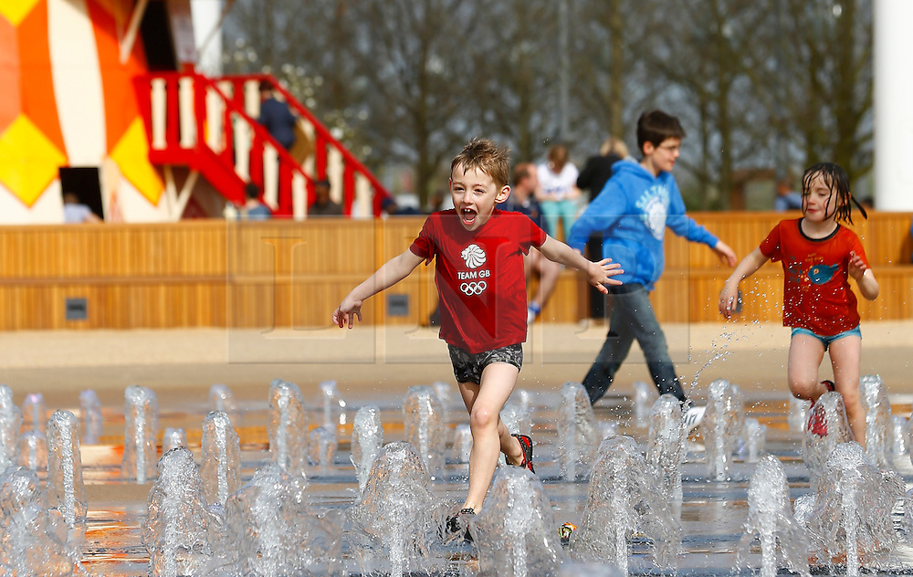 © Licensed to London News Pictures . 05/04/2014. London, UK. Children enjoy the good weather in the fountain at the Queen Elizabeth Olympic Park. The tower and park open for visitors today (05/04/2014) Photo credit: LNP