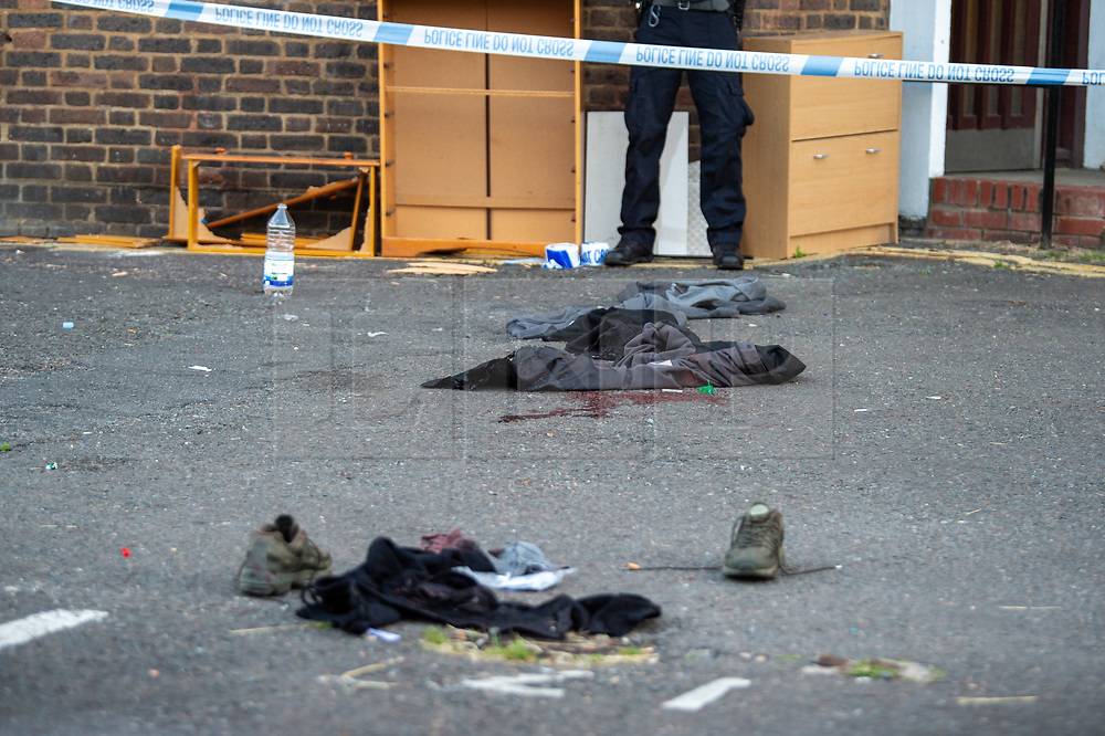 © Licensed to London News Pictures. 20/07/2020. London, UK. A pool of blood as clothes on the ground as police launch an investigation after two people were stabbed in Tower Hamlets. Photo credit: Peter Manning/LNP