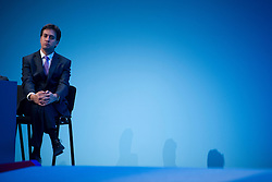 © London News Pictures. 25/09/2013 . Brighton, UK. Labour Party Leader ED MILIBAND listening to Shadow Home Secretary, Yvette Cooper speaking on the last day of the  2013 Labour Party Conference at The Brighton Centre. Photo credit : Ben Cawthra/LNP