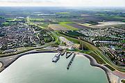 Nederland, Zeeland, Breskens, 19-10-2014; Zicht op de Veerhaven met Fast Ferry Vlissingen-Breskens (Veolia Fast Ferries Fietsvoetveer). Rechts Roompot Vakanties Zeebad,<br /> Port of Breskens, ferry terminal.<br /> luchtfoto (toeslag op standard tarieven);<br /> aerial photo (additional fee required);<br /> copyright foto/photo Siebe Swart