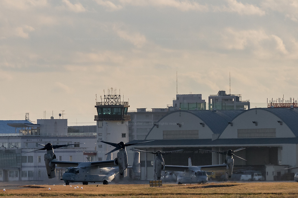 Two Bell Boeing V22 Osprey tilt-rotor aircraft with the US Marines, prepare to take off from Naval Air Facility Atsugi in Yamato, Kanagawa, Japan. Friday January 4th 2019. The Osprey is a controversial transport aircraft. With a patchy safety record it is often the focus of anti-US base and forces protests in Japan, especially in Okinawa. It is a rare visitor to this Atsugi Base.