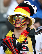 09 July 2006: Unidentified Germany fan in the stands of the Olympiastadion, pregame. Italy tied France 1-1 in overtime at the Olympiastadion in Berlin, Germany in match 64, the championship game, of the 2006 FIFA World Cup Finals. Italy won the World Cup by defeating France 5-3 on penalty kicks.