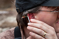 George Rogers trying to remove a steelhead fly from his ear.