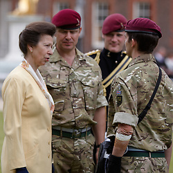 © licensed to London News Pictures. LONDON, UK  02/06/2011. The Princess Royal (L) hands out a campaign medal to Signaller Daniel O'Connor, who was injured in Afghanistan (R) and other soldiers from 216 (Parachute) Signal Squadron during a ceremony at Royal Hospital Chelsea watched by friends, family and Chelsea Pensioners. The Squadron recently returned from a 6 month tour of Afghanistan and is responsible for communications links between soldiers and commanders. A thanksgiving service was given in honour of Cpl Steven Dunn who was killed during the tour. Please see special instructions for usage rates. Photo credit should read CLIFF HIDE/LNP