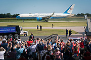Crowds cheer as Air Force One lands at President Donald Trump's campaign rally at North Star Aviation in Mankato, Minnesota on Monday, Aug. 17, 2020.