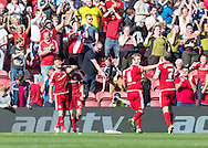 Middlesbrough FC striker Diego Fabbrini celebrates with team mates after scoring the 3rd goal during the Sky Bet Championship match between Middlesbrough and Leeds United at the Riverside Stadium, Middlesbrough, England on 27 September 2015. Photo by George Ledger.