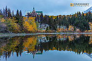 Prince of Wales Hotel reflects into Linnet Lake in Waterton Lakes National Park, Alberta, Canada