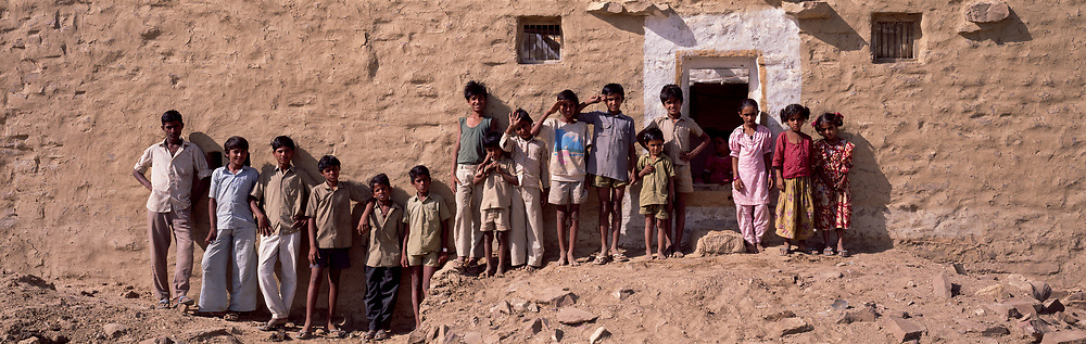 Crowd of Kids lined up against wall, Jaisalmer, Rajasthan, India, 1996