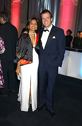 JOEL CADBURY and DIVIA LALVANI  at the Conservative Party's Black & White Ball held at Old Billingsgate, 16 Lower Thames Street, London EC3 on 8th February 2006.<br />