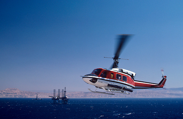 A crew helicopter with a Triton jackup oil drilling rig in the Gulf of Suez.