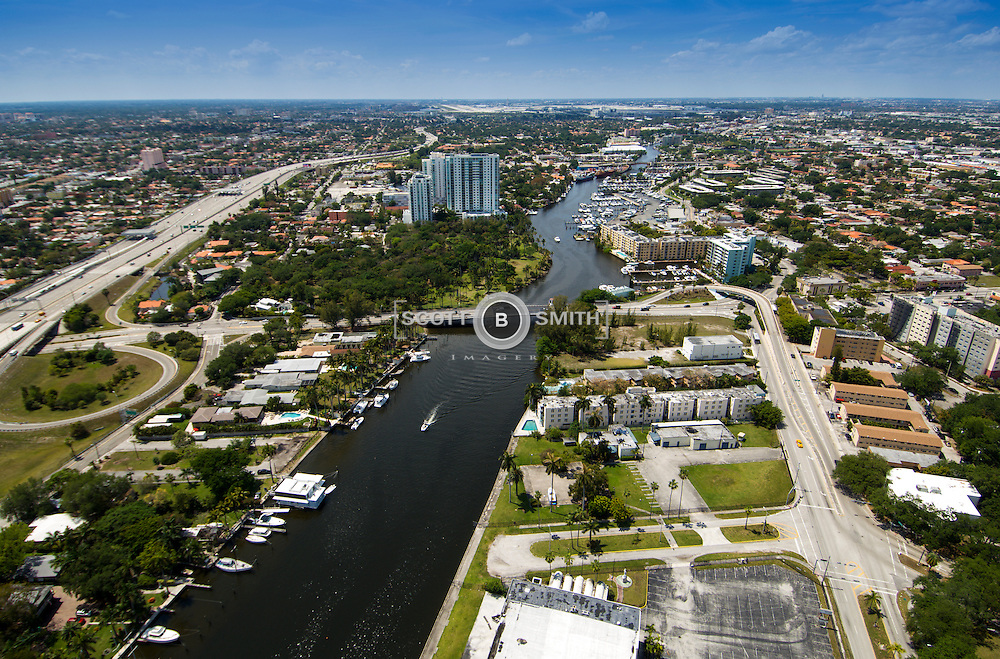 Aerial view of Miami River at 17th Avenue Bridge, City of Miami EG Sewell Park on left just above bridge.