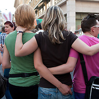 Participants hug each other during the Gay Pride Parade march in Budapest, Hungary on June 18, 2011. ATTILA VOLGYI