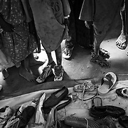 Children try on used shoes after their registration process at the registration camp in Dagahaley refugee camp in the Dadaab, in northeastern Kenya. Hundreds of thousands of refugees are fleeing lands in Somalia due to severe drought and arriving in what has become the world's largest refugee camp. Photo: Sanjit Das/Panos