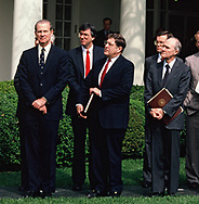 Washington, DC 1989/04/01The Bush cabinet and staff watches as  President H.W. Bush (Bush 41), and King Hussein of Jordan walk soqn thw Colonnade at the White House. (left to right: James Baker, John H. Sununu, and Brent Scowcroft)<br />Photo by Dennis Brack