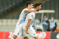 ATHENS, GREECE - OCTOBER 11: Tasos Bakasetasof Greece celebrates his goal with Petros Mantalosof Greece during the UEFA Nations League group stage match between Greece and Moldova at OACA Spyros Louis on October 11, 2020 in Athens, Greece. (Photo by MB Media)