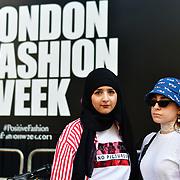 Sama Azizi @x.s13 & Eman Rostrum @lemondinary attend London Fashion Week SS19 street photography at the Strand, London, UK. 17 September 2018.
