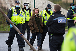 West Hyde, UK. 9th September, 2020. Hertfordshire Police officers arrest an anti-HS2 activist who used a tripod to block one of several entrances to the Chiltern Tunnel South Portal site for the HS2 high-speed rail link for the entire day. The protest action, at the site from which HS2 Ltd intends to drill a 10-mile tunnel through the Chilterns, was intended to remind Prime Minister Boris Johnson that he committed to remove deforestation from supply chains and to provide legal protection for 30% of UK land for biodiversity by 2030 at the first UN Summit on Biodiversity on 30th September.