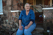 1/13/2016, Jackie Dill in front of her home in Coyle, Oklahoma that has been damaged by earthquakes. The masonry of her house continues to crack as the earthqukes continue.