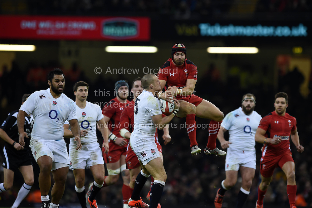 Leigh Halfpenny of Wales jumps for a high ball with Mike Brown of England. RBS Six nations championship 2015, Wales v England at the Millennium Stadium in Cardiff, South Wales on Friday 6th  Feb 2015. pic by Andrew Orchard, Andrew Orchard sports photography.