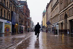 Glasgow, Scotland, UK. 7 January 2020. Scenes from morning in Glasgow city centre during the national Covid-19 lockdown. Normally busy streets are almost deserted because most shops and non essential businesses are closed.  Pic; Buchanan Street looks very quiet with shops closed.   Iain Masterton/Alamy Live News