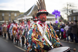 January 14, 2017 - Whittlesey, Cambridgshire, UK - Whittlesey UK. Picture shows the Red Leicester Molly dancers at the 38th Whittlesey Straw Bear Festival this weekend. In times past when starvation bit deep the ploughmen of the area where drawn to towns like Whittlesey, They knocked on doors begging for food & disguised their shame by blackening their faces with soot. In Whittlesey it was the custom on the Tuesday following Plough Monday to dress one of the confraternity of the plough in straw and call him a Straw Bear. The bear was then taken around town to entertain the folk who on the previous day had subscribed to the rustics, a spread of beer, tobacco & beef. The bear was made to dance in front of houses & gifts of money, beer & food was expected. (Credit Image: © Andrew Mccaren/London News Pictures via ZUMA Wire)