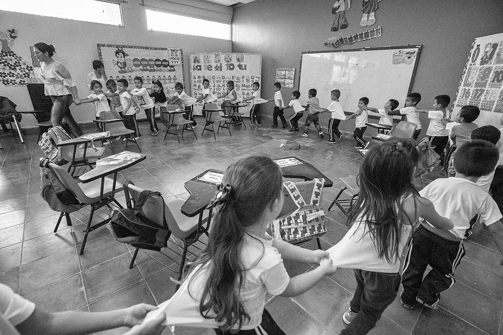 Children play and eat at Centro de Cuidadosl de fantil in Santa Rosa de Copan, Copan on Friday Oct. 18, 2019. Photo by Ken Cedeno