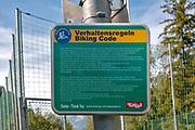 Biking code on the Inn cycle path at Prutz, Tyrol, Austria in German and English