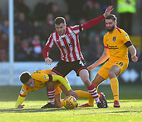 Lincoln City's Michael O'Connor battles with Northampton Town's Shaun McWilliams, left, and Jordan Turnbull<br /> <br /> Photographer Andrew Vaughan/CameraSport<br /> <br /> The EFL Sky Bet League Two - Lincoln City v Northampton Town - Saturday 9th February 2019 - Sincil Bank - Lincoln<br /> <br /> World Copyright © 2019 CameraSport. All rights reserved. 43 Linden Ave. Countesthorpe. Leicester. England. LE8 5PG - Tel: +44 (0) 116 277 4147 - admin@camerasport.com - www.camerasport.com