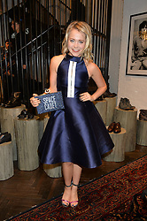POPPY JAMIE at a party to celebrate the launch of the first European John Varvatos Store, 12-13 Conduit Street, London held on 3rd September 2014.