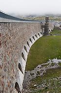 Svizzera,Alta Valposchiavo: la diga di Poschiavo adiacente al lago bianco